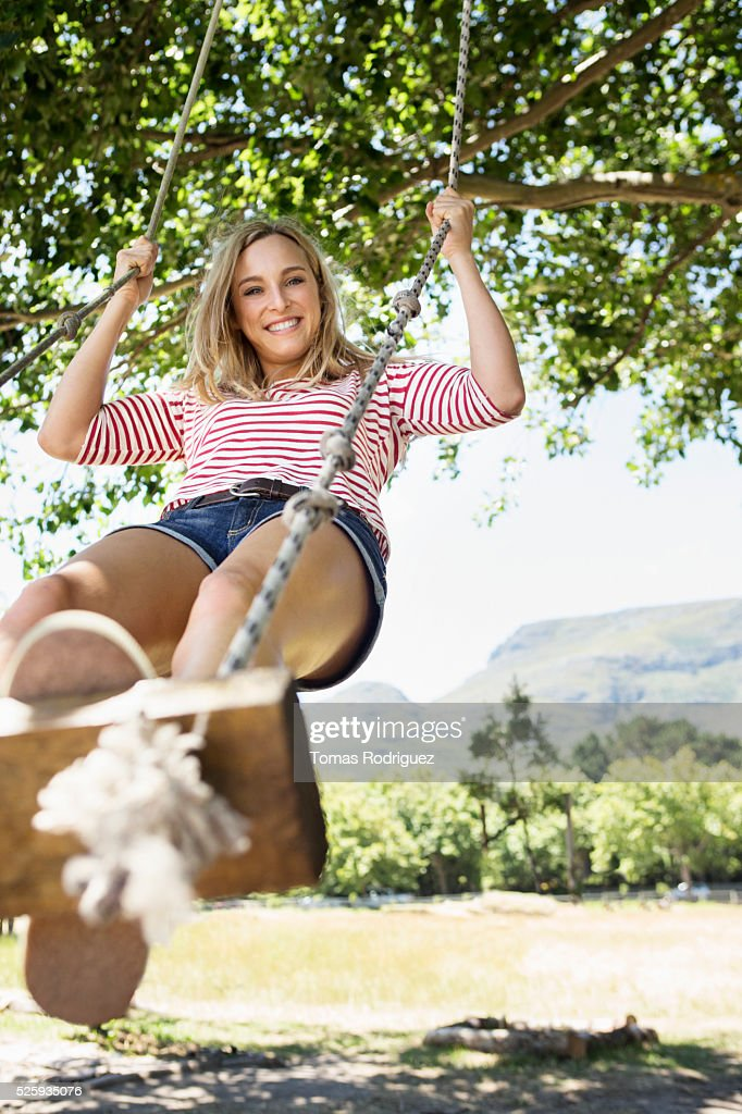 Portrait of young woman on swing : ストックフォト