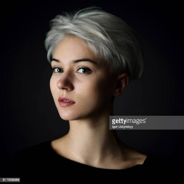 portrait of young woman on the black background - white hair stock pictures, royalty-free photos & images