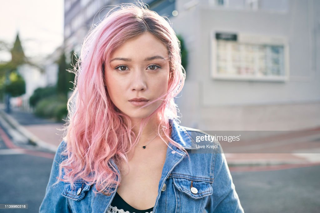 Portrait of young woman on urban street : Stock Photo