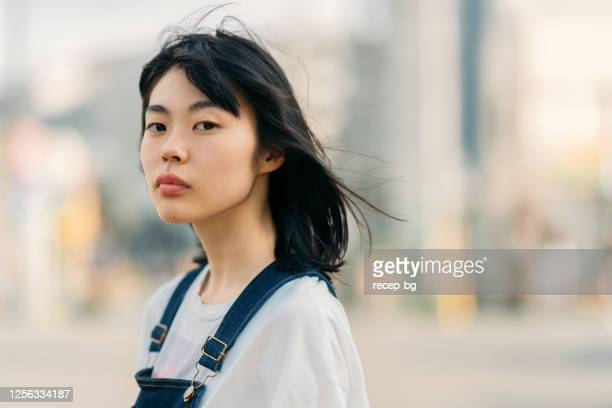portrait of young woman on windy day - adolescence stock pictures, royalty-free photos & images