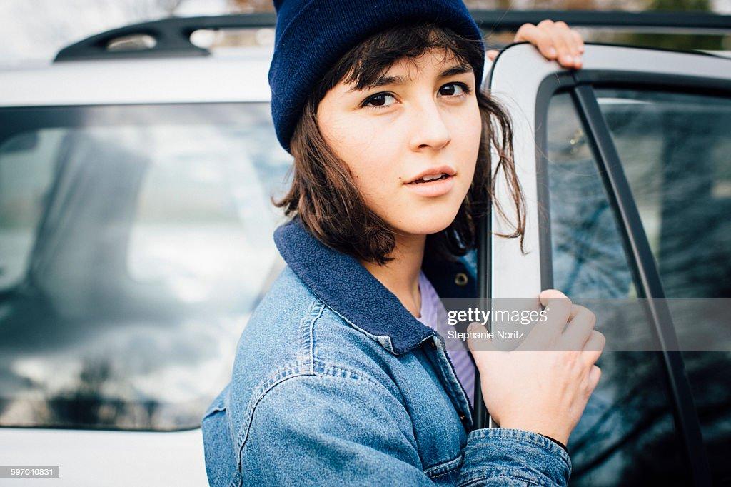 Portrait of Young Woman Opening Car Door : Stock Photo