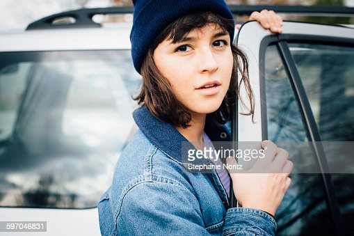 Portrait of Young Woman Opening Car Door