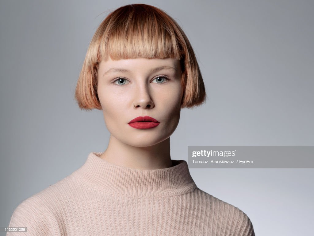 Portrait Of Young Woman Over White Background : Stock Photo