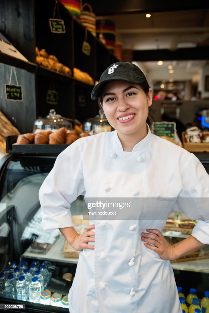 Portrait of young woman owner of a small bakery shop. : Stock Photo
