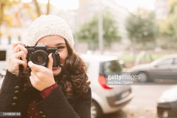 Portrait Of Young Woman Photographing With Camera