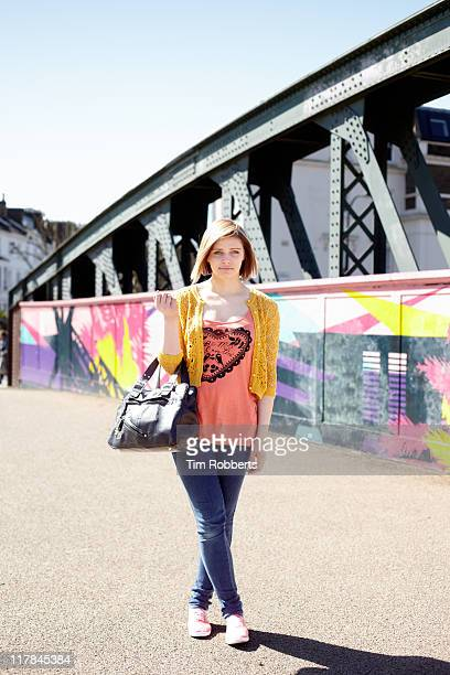 portrait of young woman. - shoulder bag stock pictures, royalty-free photos & images