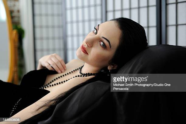 portrait of young woman - chaise longue stock photos and pictures