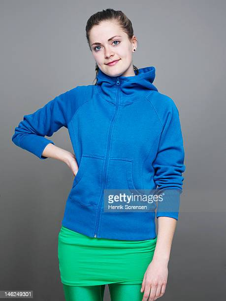 portrait of young woman - hood clothing stock photos and pictures