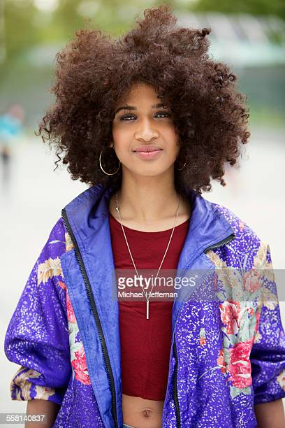 portrait of young woman - purple coat stock pictures, royalty-free photos & images
