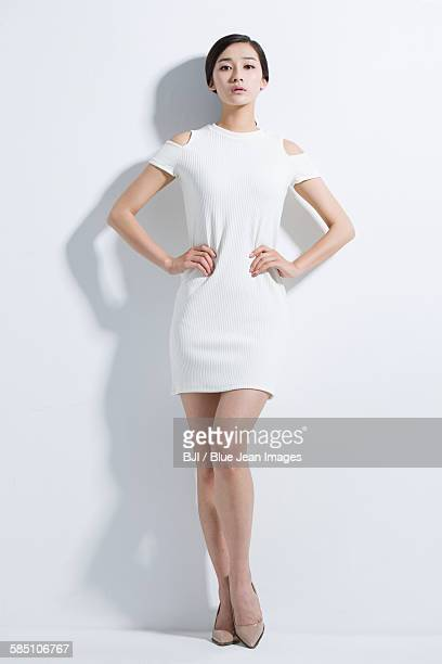 portrait of young woman - arms akimbo stock pictures, royalty-free photos & images