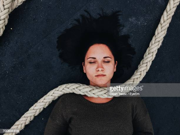 A Woman Is Suspended On A Rope Like A Marionette Stock