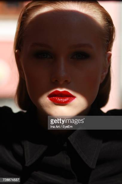 portrait of young woman - red lipstick stock pictures, royalty-free photos & images