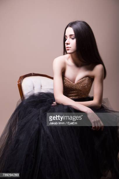 portrait of young woman - strapless evening gown stock pictures, royalty-free photos & images