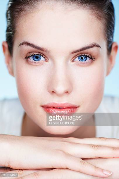 portrait of young woman - blue eyes stock pictures, royalty-free photos & images