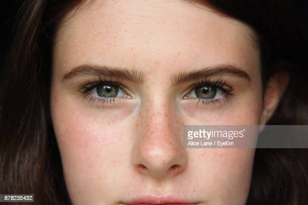 portrait of young woman - green eyes stock pictures, royalty-free photos & images