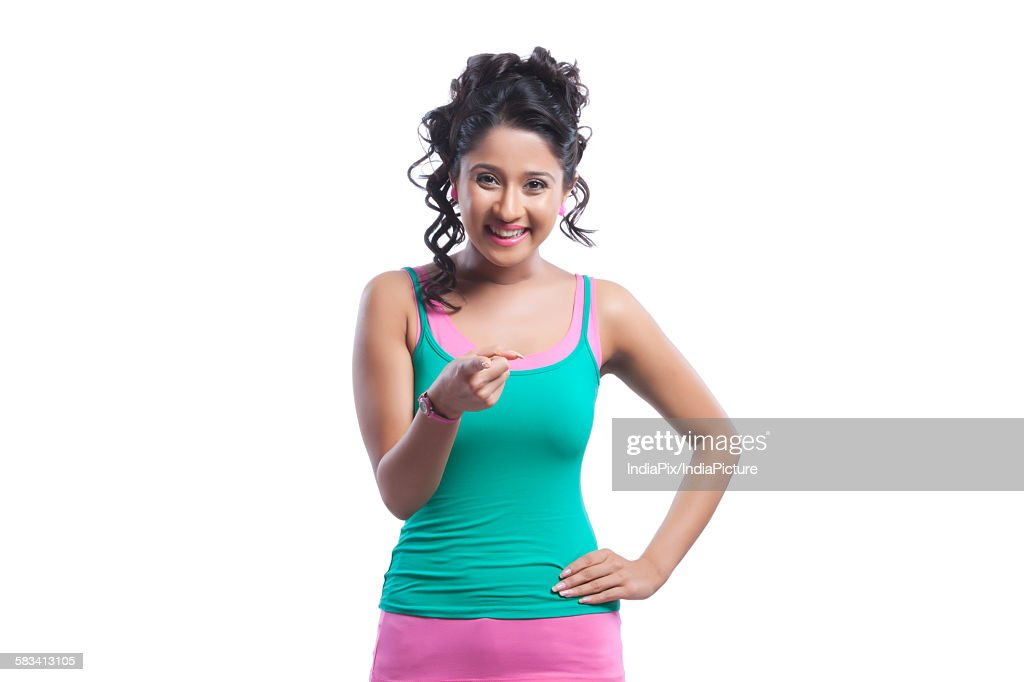 Portrait of young woman pointing : Stock Photo
