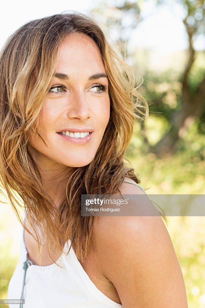 Portrait of young woman posing in park : Bildbanksbilder