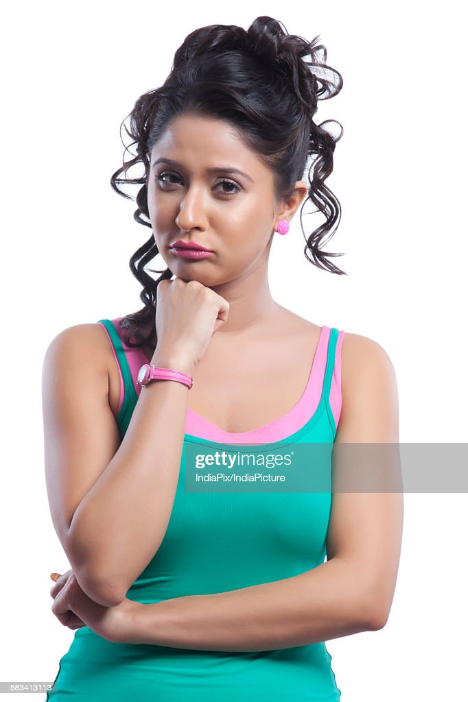 Portrait of young woman pouting : Stock Photo