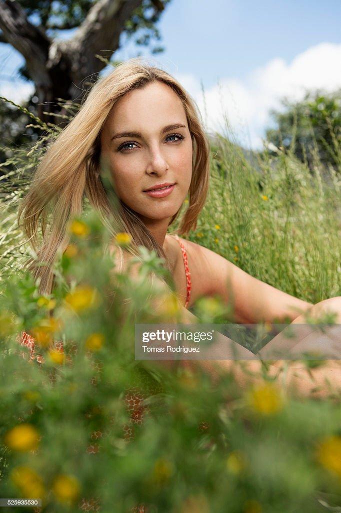 Portrait of young woman relaxing at summer : Bildbanksbilder