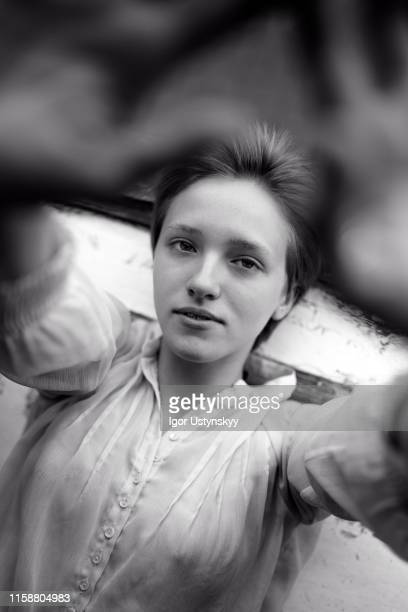 portrait of young woman resting at home - brustwarze fotos stock-fotos und bilder