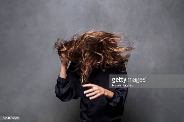 Portrait of young woman shaking her hair