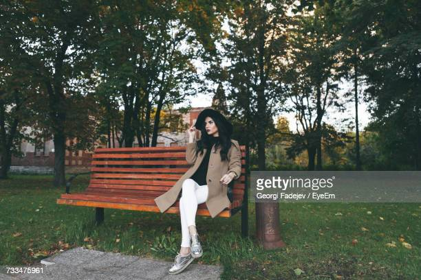 Portrait Of Young Woman Sitting At Park