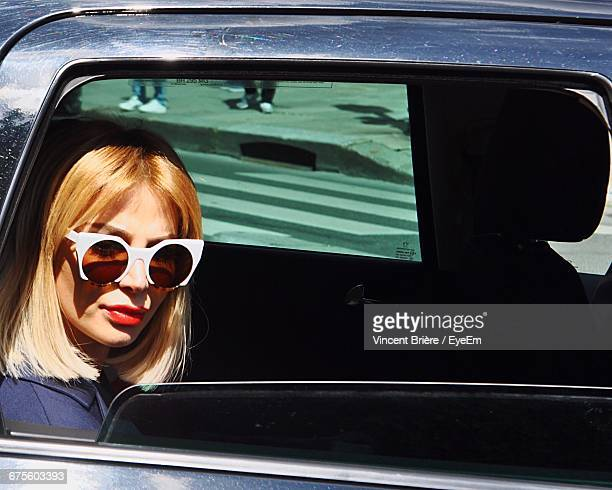 Portrait Of Young Woman Sitting In Car