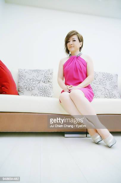 Portrait Of Young Woman Sitting Sofa At Home