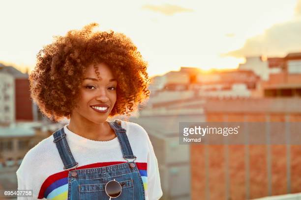 Portrait of young woman smiling on terrace