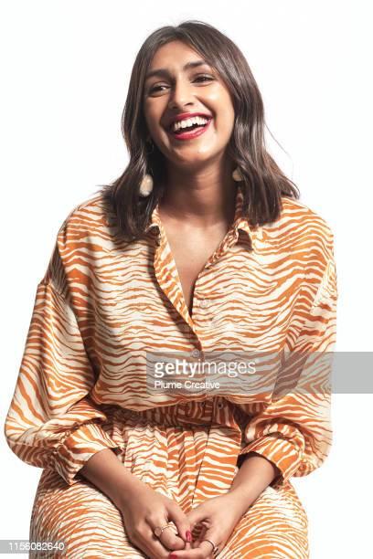 portrait of young woman smiling - india summer fotografías e imágenes de stock