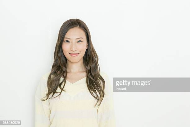 portrait of young woman, smiling - ロングヘア ストックフォトと画像