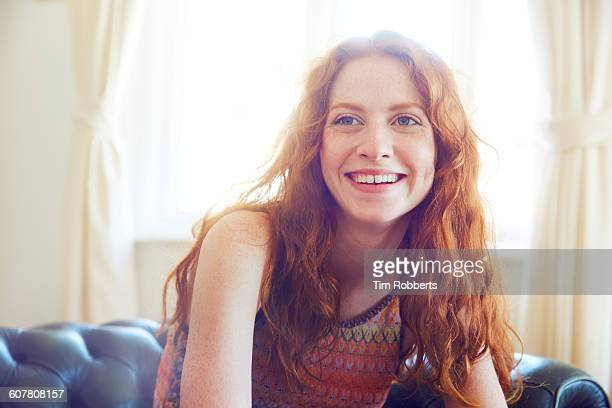 Portrait of young woman smiling.