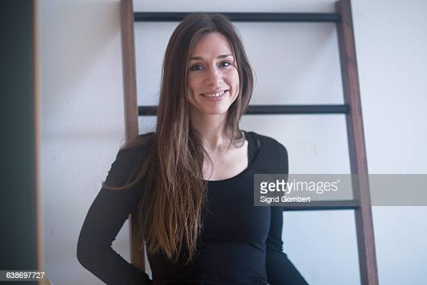 portrait of young woman, smiling - sigrid gombert stock pictures, royalty-free photos & images
