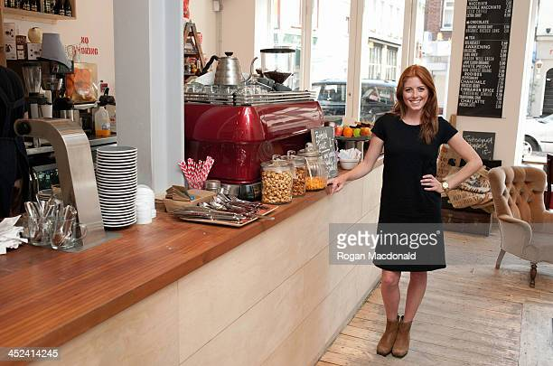 Portrait of young woman standing at cafe counter