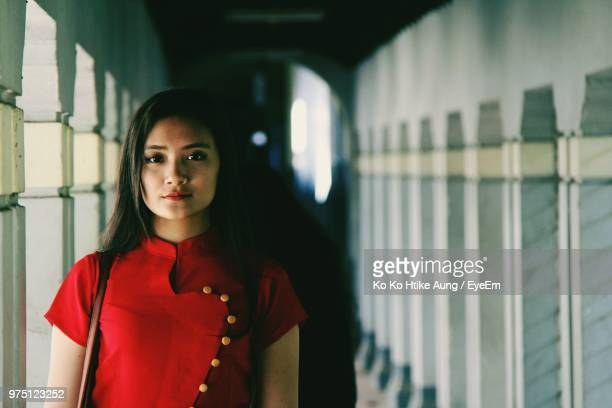 portrait of young woman standing in corridor - ko ko htike aung stock pictures, royalty-free photos & images