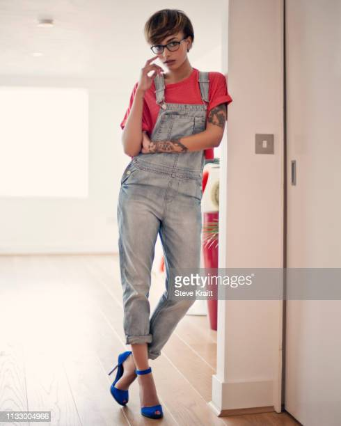 portrait of young woman standing in doorway - high heels stock pictures, royalty-free photos & images