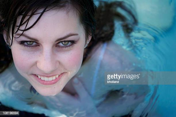 Portrait of Young Woman Standing in Swimming Pool