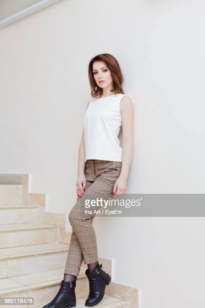 Portrait Of Young Woman Standing On Steps