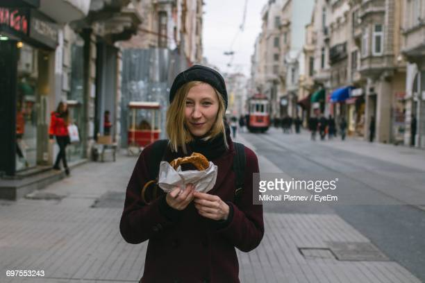Portrait Of Young Woman Standing On Street