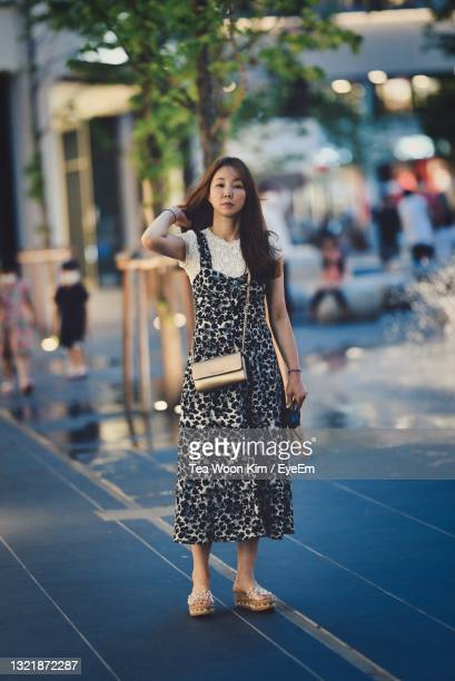 portrait of young woman standing outdoors - south korea stock pictures, royalty-free photos & images