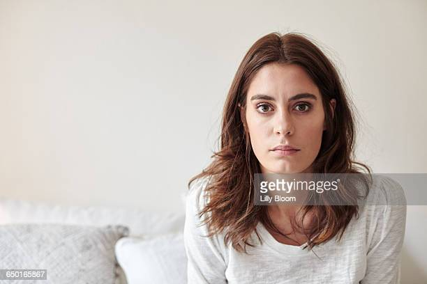 portrait of young woman staring at camera - staring stock photos and pictures