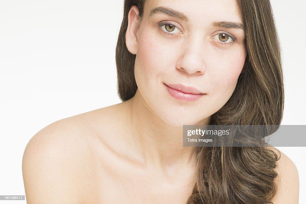 Portrait of young woman, studio shot : Stock Photo