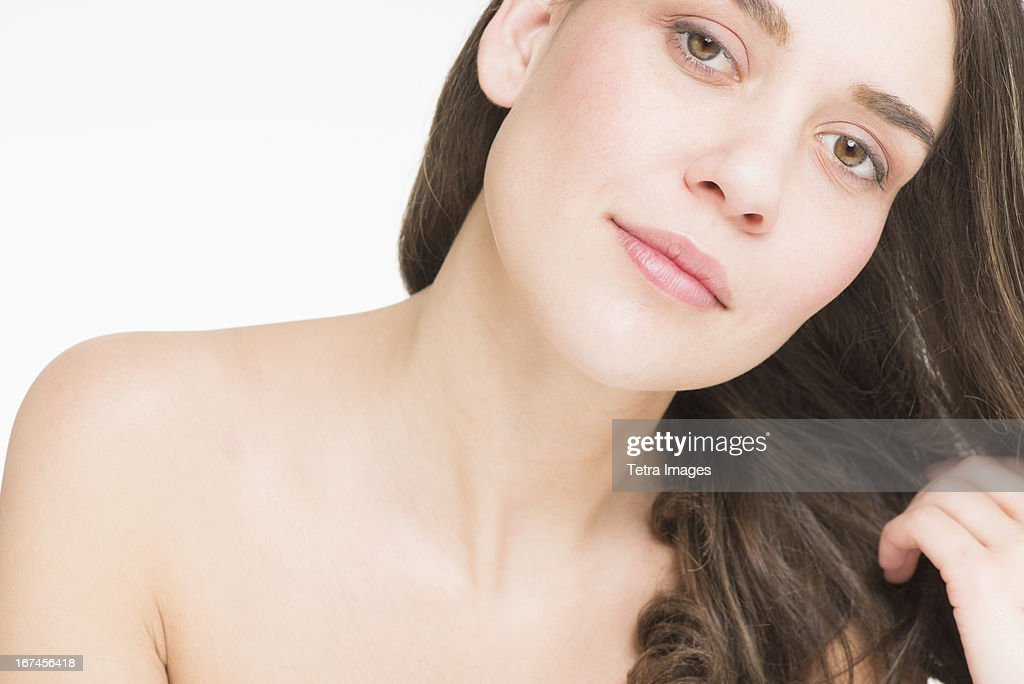 Portrait of young woman, studio shot : Stock Photo