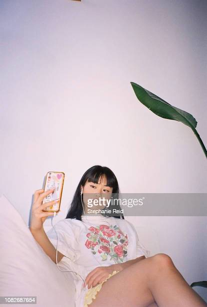 portrait of young woman taking a selfie on phone. - showus stock pictures, royalty-free photos & images