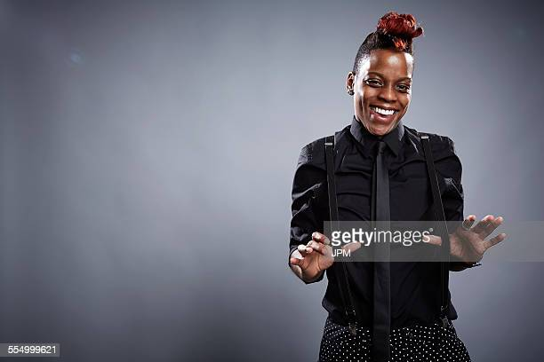 portrait of young woman, thumbs under trouser braces, laughing - suspenders stock pictures, royalty-free photos & images