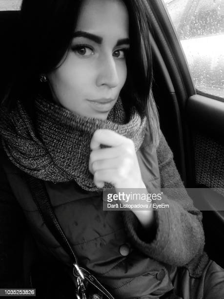 portrait of young woman traveling in car - neckwear stock pictures, royalty-free photos & images