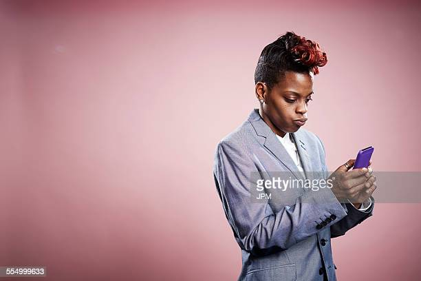 Portrait of young woman using smartphone