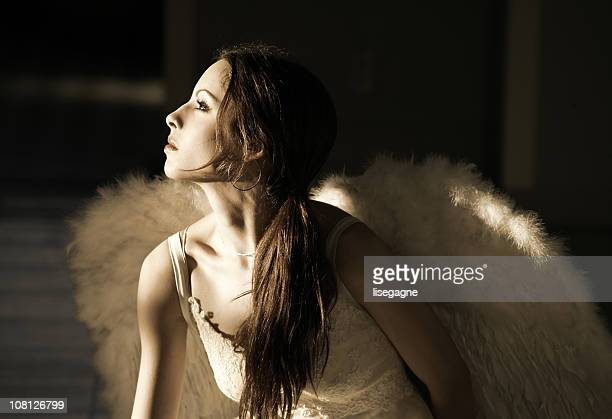 Portrait of Young Woman Wearing Angel Wings