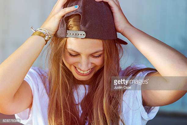 portrait of young woman wearing baseball cap - baseball cap stock pictures, royalty-free photos & images