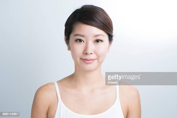 portrait of young woman, wearing camisole - cami fotografías e imágenes de stock